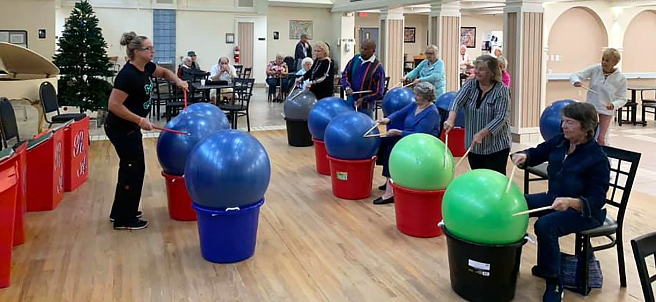 a group of senior citizens in an exercise class