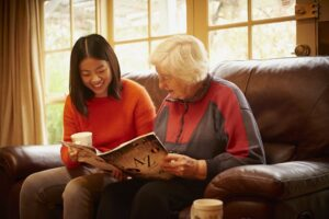 young asian woman with elderly woman in her homr