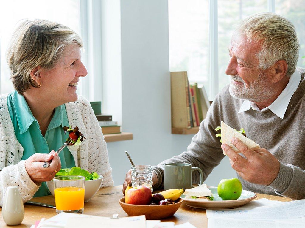 elderly-caucasian-man-woman-eating-smiling