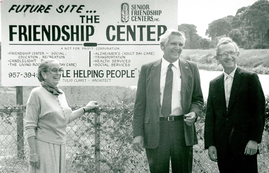 sign advertising the future site of the venice senior friendship center with one woman and two men smiling