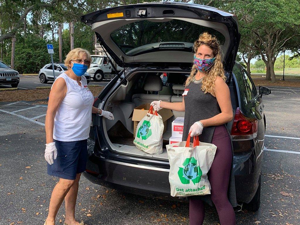 Two volunteers delivering food