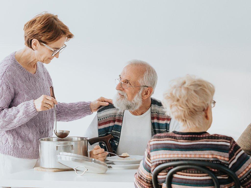 three-senior-caucasian-people-eating